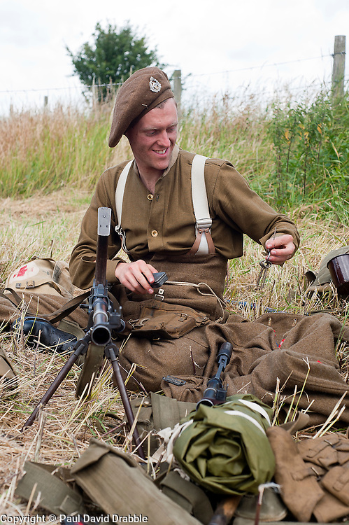 Reenactor protrays a British soldier equipped with a Bren Gun at the Spam Wartime Weekend Heckmondwike<br /> 10th July 2011<br /> Images © Paul David Drabble
