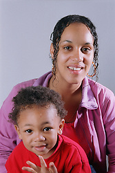 Young mother with son smiling,