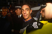 Film maker and gay-rights activist Derek Jarman is arrested by police officers at an Outrage protest on 6th February 1992 in London England.