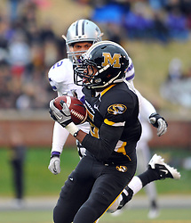 Nov 13, 2010; Columbia, MO, USA; Missouri Tigers wide receiver Rolandis Woodland (5) catches a pass as Kansas State Wildcats cornerback Tysyn Hartman (2) attempts coverage in the second half at Memorial Stadium. Missouri won 38-28.  Mandatory Credit: Denny Medley-US PRESSWIRE