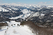 View of Tadami from the local ski slope. Nekka Shochu Distillery, Tadami, Fukushima, Japan, February 22, 2018. The Nekka shochu distillery was founded in July 2016 and at that time was the smallest shochu distillery in Japan. It makes shochu from locally-grown rice, and is helping support a local economy that has languished since the nuclear disaster of 2011.