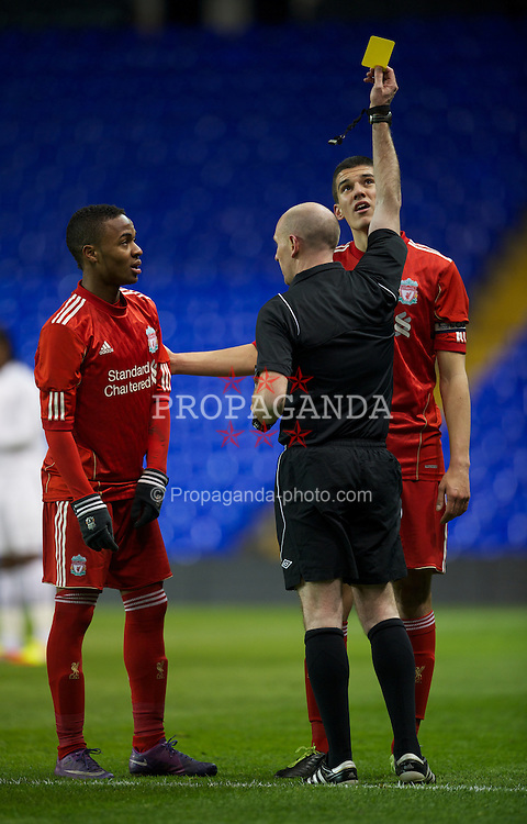LONDON, ENGLAND - Wednesday, February 1, 2012: Liverpool's Raheem Sterling (L) is shown the yellow card by the referee during the NextGen Series Quarter-Final match against Tottenham Hotspur at White Hart Lane. (Pic by David Rawcliffe/Propaganda)
