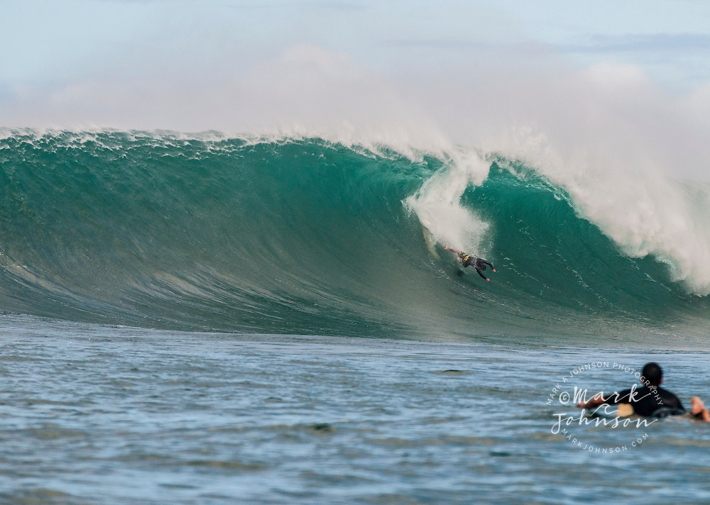 Surfer wiping out on a big wave in Hawaii