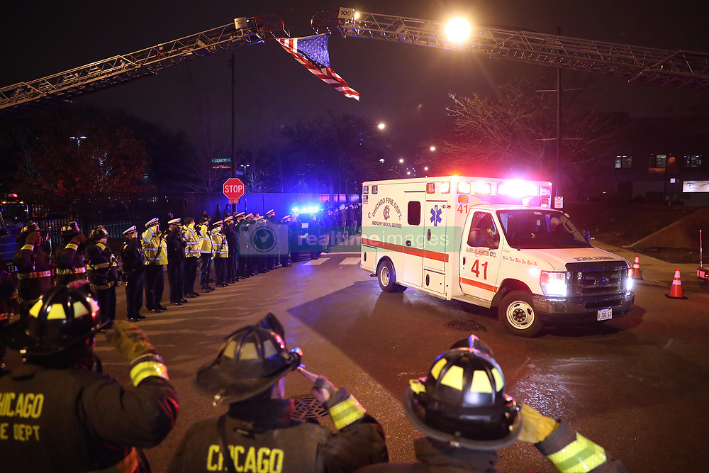 Chicago firefighters and police salute the ambulance carrying the body of Officer Samuel Jimenez outside of the Medical Examiners office at Leavitt and West Harrison streets in Chicago on November 19, 2018. Jimenez was killed at Mercy Hospital today. Photo by Armando Sanchez/Chicago Tribune/TNS/ABACAPRESS.COM