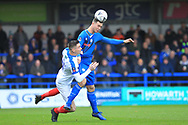 Harrison McGahey clears under pressure during the The FA Cup 2nd round match between Rochdale and Portsmouth at Spotland, Rochdale, England on 2 December 2018.