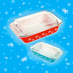 Mid century festive glass casserole dishes on winter snowy blue background with white snowflakes