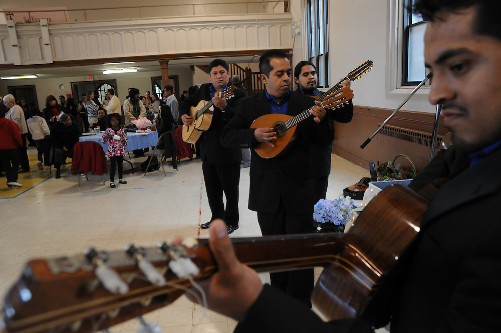Guitarists grace the open-house crowd gathered in the gym of the newly-inaugurated Quinn Community Center in Maywood. The project to revitalize the building was undertaken by Pastor Carmelo Mendez, naming the center for former St. Eulalia Pastor William Quinn. Quinn made a lasting history for himself as a pioneer for social justice, both in the fields of civil rights, along with those of immigrants in the U.S. He died in 2004.