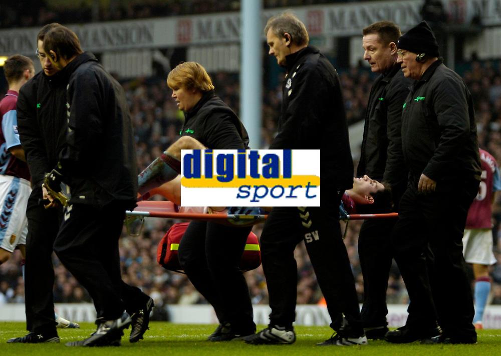 Photo: Ed Godden.<br /> Tottenham Hotspur v Aston Villa. The Barclays Premiership. 26/12/2006. Villa's Aaron Hughes is stretchered off the pitch.