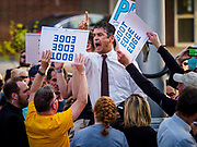 "16 APRIL 2019 - DES MOINES, IOWA:  Supporters of Pete Buttigieg try to block a heckler shouting homophobic slurs during a campaign rally in Des Moines for Mayor Pete Buttigieg, the mayor of South Bend, Indiana. ""Mayor Pete,"" as he goes by, declared his candidacy to be the Democratic nominee for the US Presidency on April 14. About 1,000 people attended his first rally in Iowa since officially declaring his candidacy. Iowa traditionally hosts the the first selection event of the presidential election cycle. The Iowa Caucuses will be on Feb. 3, 2020.               PHOTO BY JACK KURTZ"