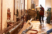 In the winery, concrete fermentation tanks and men working with pumping and emptying the vats. Chateau Mourgues du Gres Grès, Costieres de Nimes, Bouches du Rhone, Provence, France, Europe