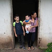 Edna Lourdes Barahona Rivera with her baby Maynor José and her son Danny Javier. Edna lives on a Fairtrade-certified coffee farm in La Laguna, Santa Barbara, Honduras