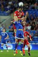 Blackburn's Shane Duffy (red) beats Cardiff City's Lex Immers to a header. EFL Skybet championship match, Cardiff city v Blackburn Rovers at the Cardiff city stadium in Cardiff, South Wales on Wednesday 17th August 2016.<br /> pic by Carl Robertson, Andrew Orchard sports photography.
