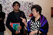HERI DEMAD; POPPY HADIMAN, Indonesian Eye Contemporary Art Exhibition Reception, Saatchi Gallery. London. 9 September 2011. <br /> <br />  , -DO NOT ARCHIVE-© Copyright Photograph by Dafydd Jones. 248 Clapham Rd. London SW9 0PZ. Tel 0207 820 0771. www.dafjones.com.