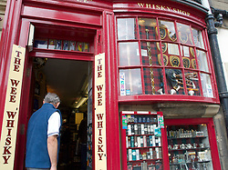 Small specialist whisky shop on Royal Mile street in Edinburgh Scotland