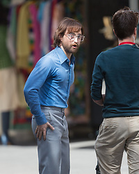 AU_1515591 - *PREMIUM-EXCLUSIVE* Adelaide, AUSTRALIA  -  *EXCLUSIVE*  - Daniel Radcliffe was spotted filming scenes in Adelaide's Pirie st on Wednesday as filming hit its second week in Australia.<br /> <br /> Daniel was transformed into Tim Jenkins a white South African activist imprisoned for working with the African National Congress, who breaks out of the brutal Robben Island Prison.<br /> <br /> Daniel filmed scenes in which he hid from law enforcement and went through garbage. These scenes must take place in the movie after he has already escaped prison.<br /> <br /> He was dressed in a blue long sleeve shirt and grey pants fit for the time period of the 1970's. In between breaks the actor wasn't affraid to light up a cigarette and smile at onlookers.<br /> <br /> Pictured: Daniel Radcliffe<br /> <br /> BACKGRID Australia 13 MARCH 2019 <br /> <br /> Phone: + 61 419 847 429<br /> Email:  sarah@backgrid.com.au
