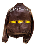 """This type A-2 flight jacket belonged to Thomas F. Murphy, a tail gunner attached to the 569th squadron of the 390th Bomb Group. On the back of the jacket is the name of Murphy's aircraft the """"Gloria Ann"""". There are 27 bombs painted on the back of the jacket signifying the amount of successful missions Murphy flew. On the 27th mission, a raid on Berlin, Germany on March 6, 1944, the """"Gloria Ann"""" suffered severe damage but was able to fly back to base. Due to the damage suffered on this mission """"Gloria Ann"""" was salvaged after 27 completed missions."""
