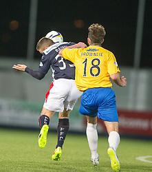 Falkirk's John Baird tackled by Cowdenbeath's Darren Brownlie. <br /> Falkirk 1 v 0 Cowdenbeath, Scottish Championship game played 31/3/2015 at The Falkirk Stadium.
