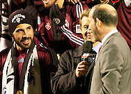 Colorado captain, Pablo Mastroeni (left) looks on to MLS Commissioner DOn Garber after his team, the Colorado Rapids, defeated FC Dallas 2-1 in the 2010 MLS Cup.