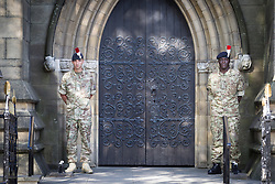 © Licensed to London News Pictures . 11/07/2013 . Bury , UK . An honour guard outside the church doors after the service . The honour guard will stay in place overnight , until the funeral service tomorrow  . Drummers from the 2nd Battalion Royal Regiment of Fusiliers ( 2RRF ) drum the funeral cortege of Fusilier Lee Rigby up Bolton Street and in to Bury Parish Church in Bury town centre today (Thursday 11th July 2013) , watched by 100s of people . Fusilier Rigby's coffin will remain in Bury Parish Church overnight , with an honour guard of soldiers from the Regiment . His funeral is tomorrow (12th July) . Rigby was brutally murdered in Woolwich , London on . Photo credit : Joel Goodman/LNP