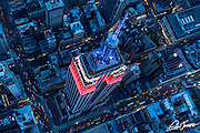 Aerial view from over the Empire State Building at dusk, New York City, photographed from a helicopter. The building was lit red, white and blue in honor of the Fourth of July holiday season.