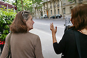 Annie Boulat and Faith D'Aluisio on their way to lunch near Cosmos offices, Paris, France.