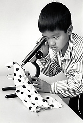 Schoolboy looking through a microscope, primary school Nottingham UK 1992