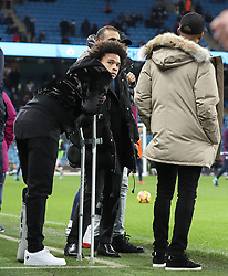 Manchester City's Leroy Sane with crutches and his leg in a brace before the Premier League match at The Etihad Stadium, Manchester.