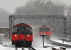 © Licensed to London News Pictures. 18/01/2013. London, UK Piccadilly Line and a District Line tube train in the snow in West London today 18th January 2013. Photo credit : Stephen Simpson/LNP