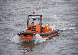 © Licensed to London News Pictures. 09/01/2020. London, UK. An RNLA vessel near Blackfriars Bridge in choppy waters on the Thames as London braces for high winds and heavy squally rain during this evening's rush hour. Storm Brendan is forecast to blow in towards the South East with winds expected to peak up to 45mph. Photo credit: Alex Lentati/LNP