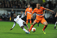Swansea city's Nathan Dyer (l) is tackled by Valencia's Oriol Romeu.UEFA Europa league match, Swansea city v Valencia at the Liberty Stadium in Swansea on Thursday 28th November 2013. pic by Andrew Orchard, Andrew Orchard sports photography,