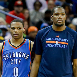 Dec 2, 2014; New Orleans, LA, USA; Oklahoma City Thunder forward Kevin Durant (right) and guard Russell Westbrook (0) during the second half of a game against the New Orleans Pelicans at the Smoothie King Center. The Pelicans defeated the Thunder 112-104. Mandatory Credit: Derick E. Hingle-USA TODAY Sports
