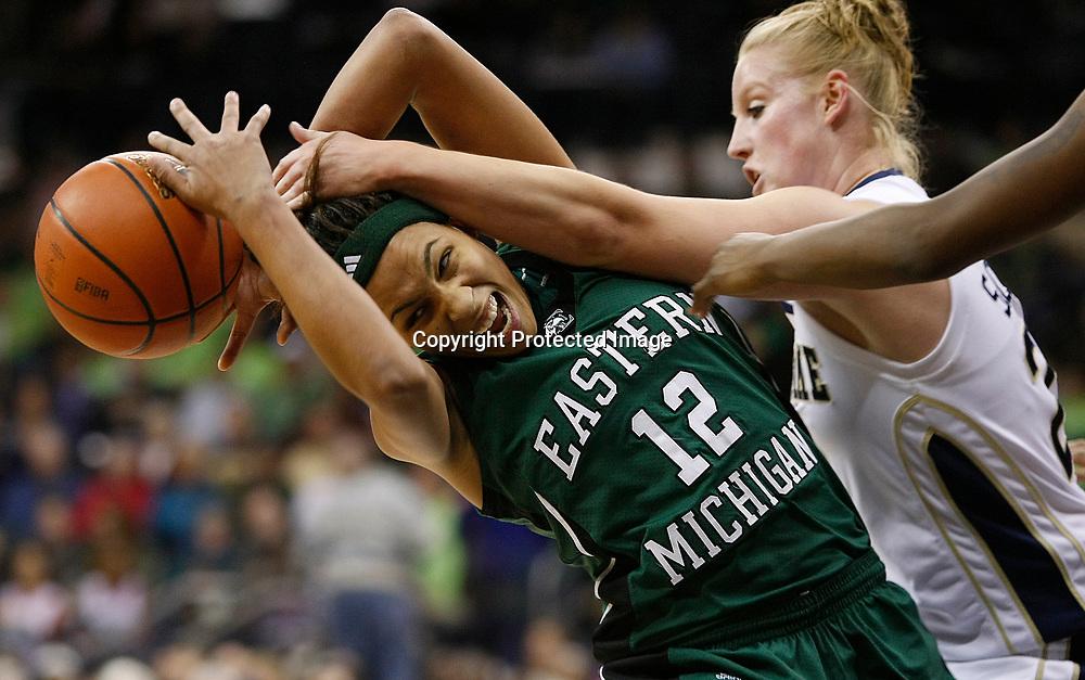 Tribune Photo/SANTIAGO FLORES<br /> Notre Dame's Lindsay Schrader (24) fouls Eastern Michigan's Lindsey Mahone (12).