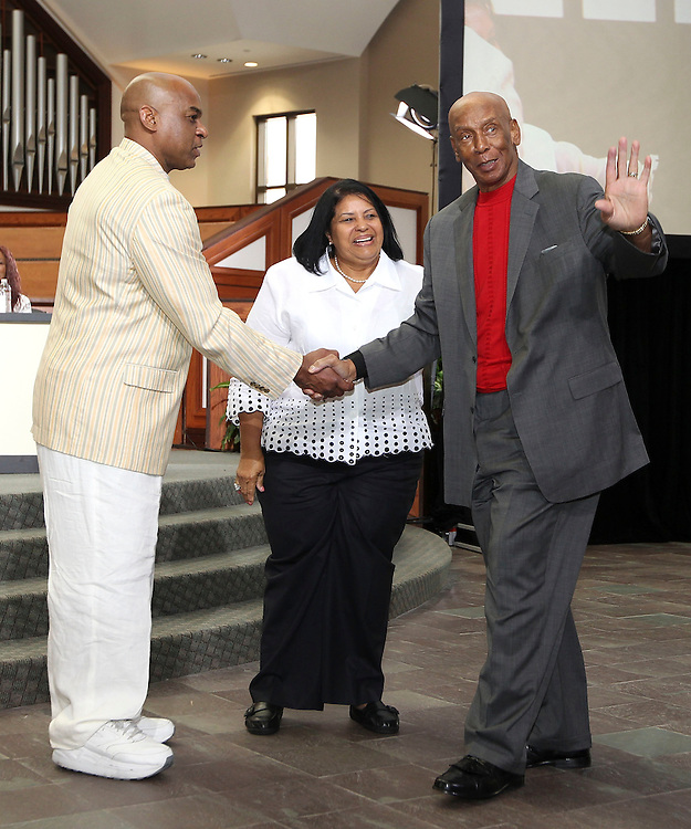 ATLANTA, GA - MAY 13:  Former NFL star Reggie Williams shakes hands with Hall of Famer Ernie Banks (R) while Vera Clemente, widow of Roberto Clemente, looks on at the Baseball and the Civil Rights Movement Roundtable panel at Ebenezer Baptist Church on May 13, 2011 in Atlanta, Georgia.  (Photo by Mike Zarrilli/Getty Images)