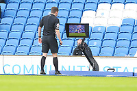 Football - 2020 / 2021 Premier League - Brighton and Hove Albion vs. Sheffield United - The Amex Stadium<br /> <br /> Referee Mr Peter Bankes checks the VAR screen before changing his decision on giving John Lundstram of Sheffield United a yellow card and upgrades it to a straight red for serious foul play during the Premier League match at The Amex Stadium Brighton <br /> <br /> COLORSPORT/SHAUN BOGGUST