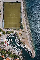 THEMENBILD - der Trainingsplatz des alten Stadion Kantrida des HNK Rijeka liegt direkt am Meer und grenzt an einem Badestrand und einem Yachthafen an, es ist ein Neubau an dieser Stelle geplant, aufgenommen am 14. August 2019 in Rijeka, Kroatien // the Training ground of the old stadium Kantrida of the HNK Rijeka is situated directly at the coast and adjacent to a beach and a marina, a new stadium is planned at this location in Rijeka, Croatia on 2019/08/14. EXPA Pictures © 2019, PhotoCredit: EXPA/ JFK