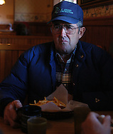 CM-12/27/03 North Platte, Neb .   Gary Kuhlmann has been a rancher in Nebraska for generations.  Kuhlman sits down to have dinner at Merricks restaraunt in North Platte Nebraska on Saturday afternoon with friend Marvin Knoll at Merricks Ranch House.   Kuhlmann and Knoll have been friends since high school.For a story on Mad Cow Disease and its affect in Nebraska. (photo by Chris Machian/Prairie Pixel Group).