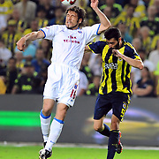 Fenerbahce's Daniel Gonzalez GUIZA (R) and Trabzonspor's Egemen KORKMAZ (L) during their Turkish superleague soccer derby match Fenerbahce between Trabzonspor at the Sukru Saracaoglu stadium in Istanbul Turkey on Sunday 16 May 2010. Photo by TURKPIX