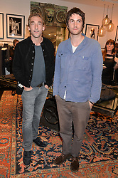 Left to right, JOSEPH MAWLE and JIM STURGESS at a party to celebrate the launch of the first European John Varvatos Store, 12-13 Conduit Street, London held on 3rd September 2014.