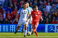 Wales midfielder Harry Wilson passes the ball during the UEFA European 2020 Qualifier match between Wales and Slovakia at the Cardiff City Stadium, Cardiff, Wales on 24 March 2019.