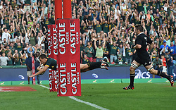 04/10/2014. All Blacks captain Ritchie McCaw watches as Handre Pollard of the Springboks dives over the line to score the second try of the day during the test match held at Ellis Park Stadium. <br /> <br /> Picture: Masi Losi