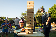Wei Zhou plays Jenga during National Night Out at Sandalwood Park in Milpitas, California, on August 4, 2016. (Stan Olszewski/SOSKIphoto)