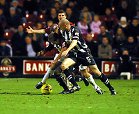 Photo: Dave Linney.<br />Walsall v Notts County. Coca Cola League 2. 25/11/2006.<br />Walsall's Martin Butler(L) battles with   Alan White