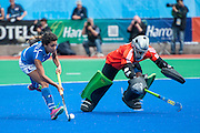 Dalila Mirabella of Italy takes on South Africa's Vuyisanani Mangisa in the penalty shoot out during their match in the Investec Hockey World League Semi Final 2013, Quintin Hogg Memorial Sports Ground, University of Westminster, London, UK on 29 June 2013. Photo: Simon Parker