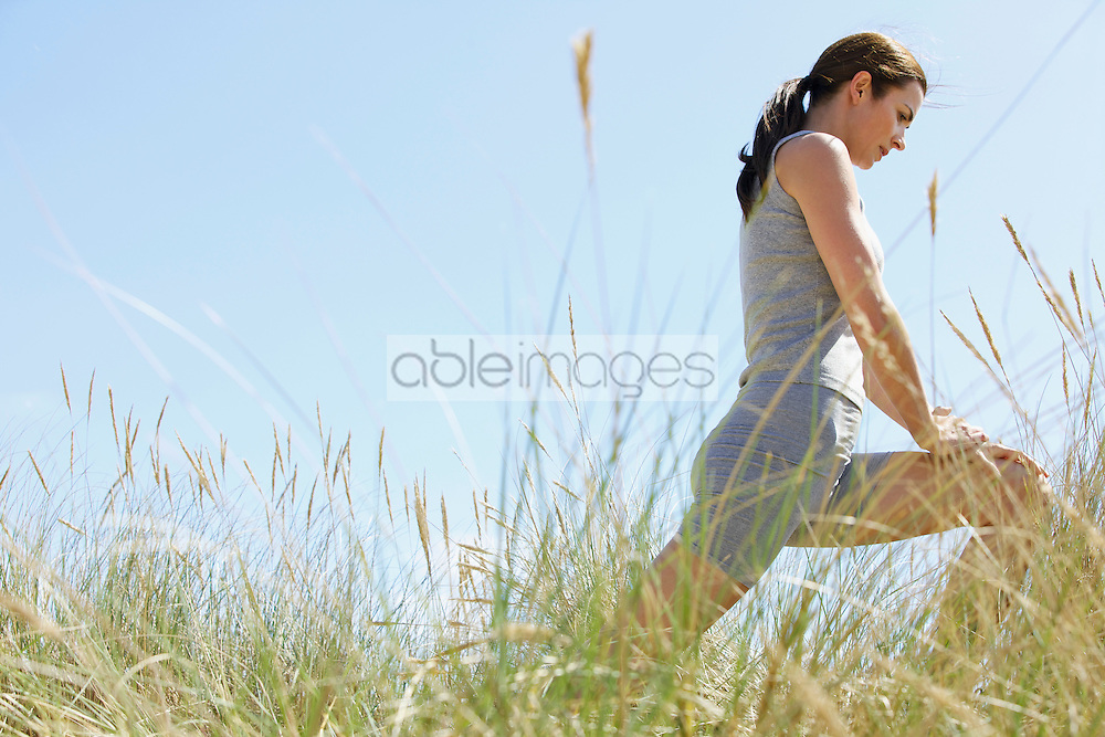 Woman Stretching Legs Outdoors