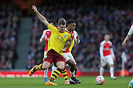 Sam Vokes of Burnley challenging Alex Iwobi of Arsenal. The Emirates FA cup, 4th round match, Arsenal v Burnley at the Emirates Stadium in London on Saturday 30th January 2016.<br /> pic by John Patrick Fletcher, Andrew Orchard sports photography.