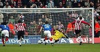 Fotball<br /> FA-cup 2005<br /> Southampton v Portsmouth<br /> 29. januar 2005<br /> Foto: Digitalsport<br /> NORWAY ONLY<br /> Peter Crouch sends Portsmouth keeper Kosta Chalkias the wrong way to put Southampton through