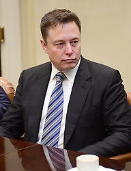 File photo - Elon Musk of Space X listens as United States President Donald Trump makes remarks during a breakfast and listening session with key business leaders in the Roosevelt Room of the White House in Washington, DC on Monday, January 23, 2017. - Tech entrepreneur Elon Musk has revealed he has Asperger's syndrome while appearing on the US comedy sketch series Saturday Night Live (SNL). Photo by Ron Sachs / Pool via CNP /ABACAPRESS.COM