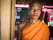 25 MAY 2013 - MAE SOT, TAK, THAILAND:  The Abbot of a Buddhist temple in an unofficial village of Burmese refugees north of Mae Sot, Thailand. They live on a narrow strip of land about 200 meters deep and 400 meters long that juts into Thailand. The land is technically Burma but it is on the Thai side of the Moei River, which marks most of the border in this part of Thailand. The refugees, a mix of Buddhists and Christians, settled on the land years ago to avoid strife in Myanmar (Burma). For all practical purposes they live in Thailand. They shop in Thai markets and see their produce to Thai buyers. About 200 people live in thatched huts spread throughout the community. They're close enough to Mae Sot that some can work in town and Burmese merchants from Mae Sot come out to their village to do business with them.   PHOTO BY JACK KURTZ