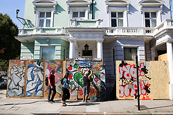 © Licensed to London News Pictures. 22/08/2019. London, UK. A workman boards up a residential property ahead of the 2019 Notting Hill Carnival in West London, which takes place this bank holiday weekend. Up to 1 million people are expected to attend the biggest street party in Europe. Photo credit: Dinendra Haria/LNP