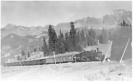 Leased D&RGW #464 approaching RGS snowshed on Lizard Head Pass with southbound stock cars and box cars.<br /> RGS  Lizard Head, CO  Taken by Perry, Otto C. - 9/28/1946<br /> Thanks to Don Bergman for additional information.
